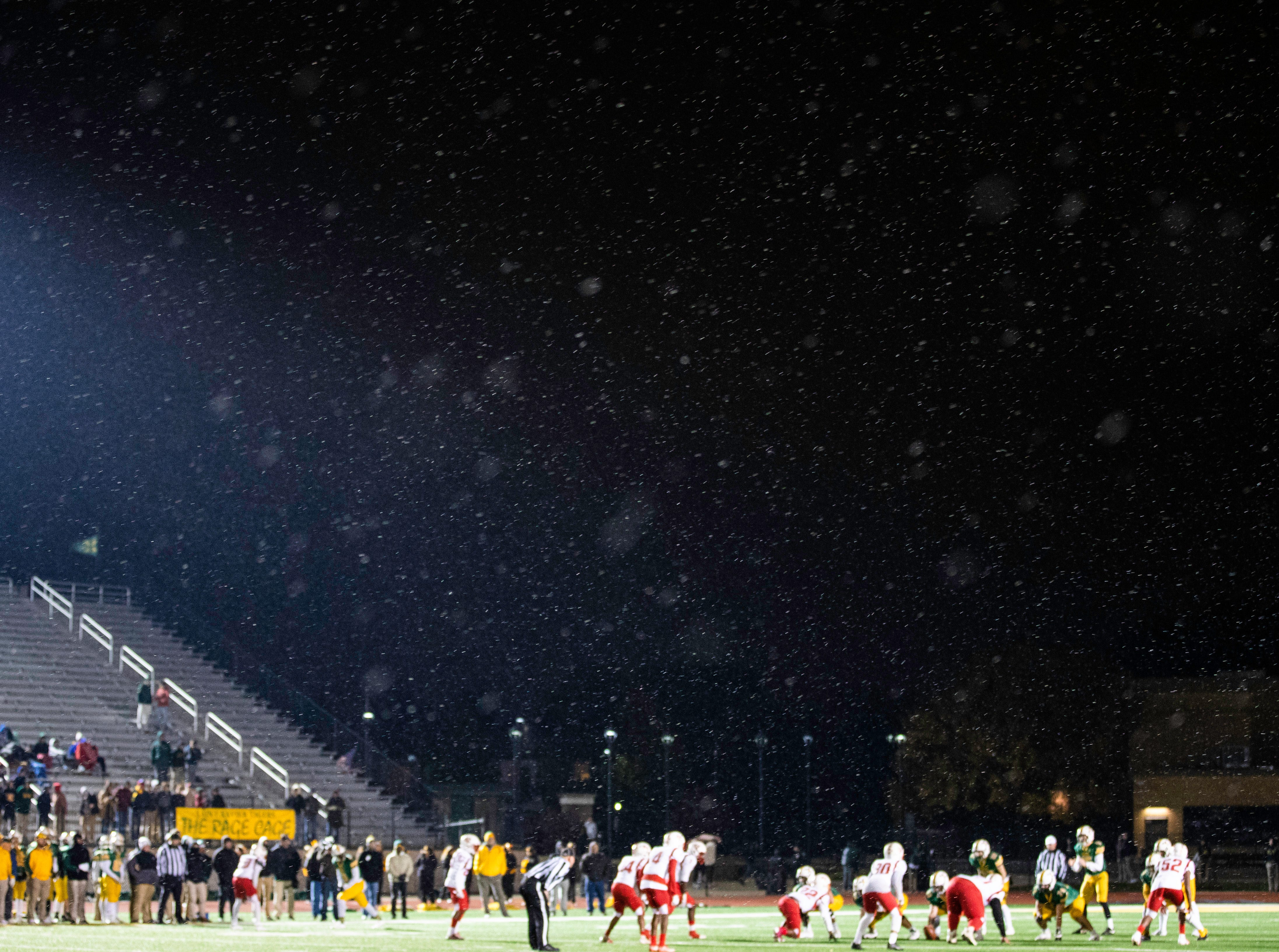 Snow fell late in the fourth quarter of KHSAA regional playoff game between the Butler Bears and St. Xavier Tigers at St. Xavier High School, Friday, Nov. 9, 2018.