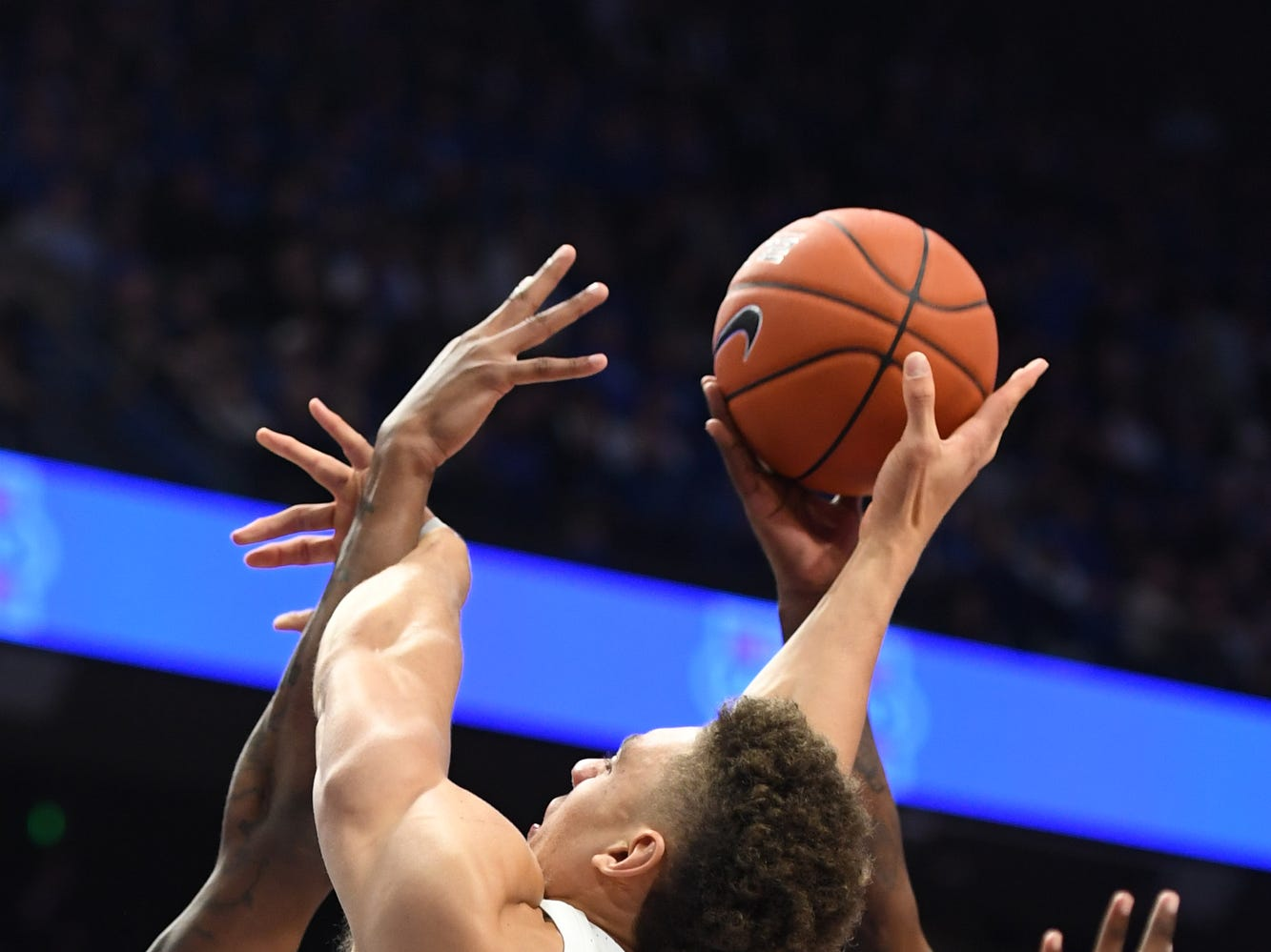 UK R Reid Travis is blocked during the University of Kentucky mens basketball game against Southern Illinois at Rupp Arena in Lexington, Kentucky on Friday, November 9, 2018.