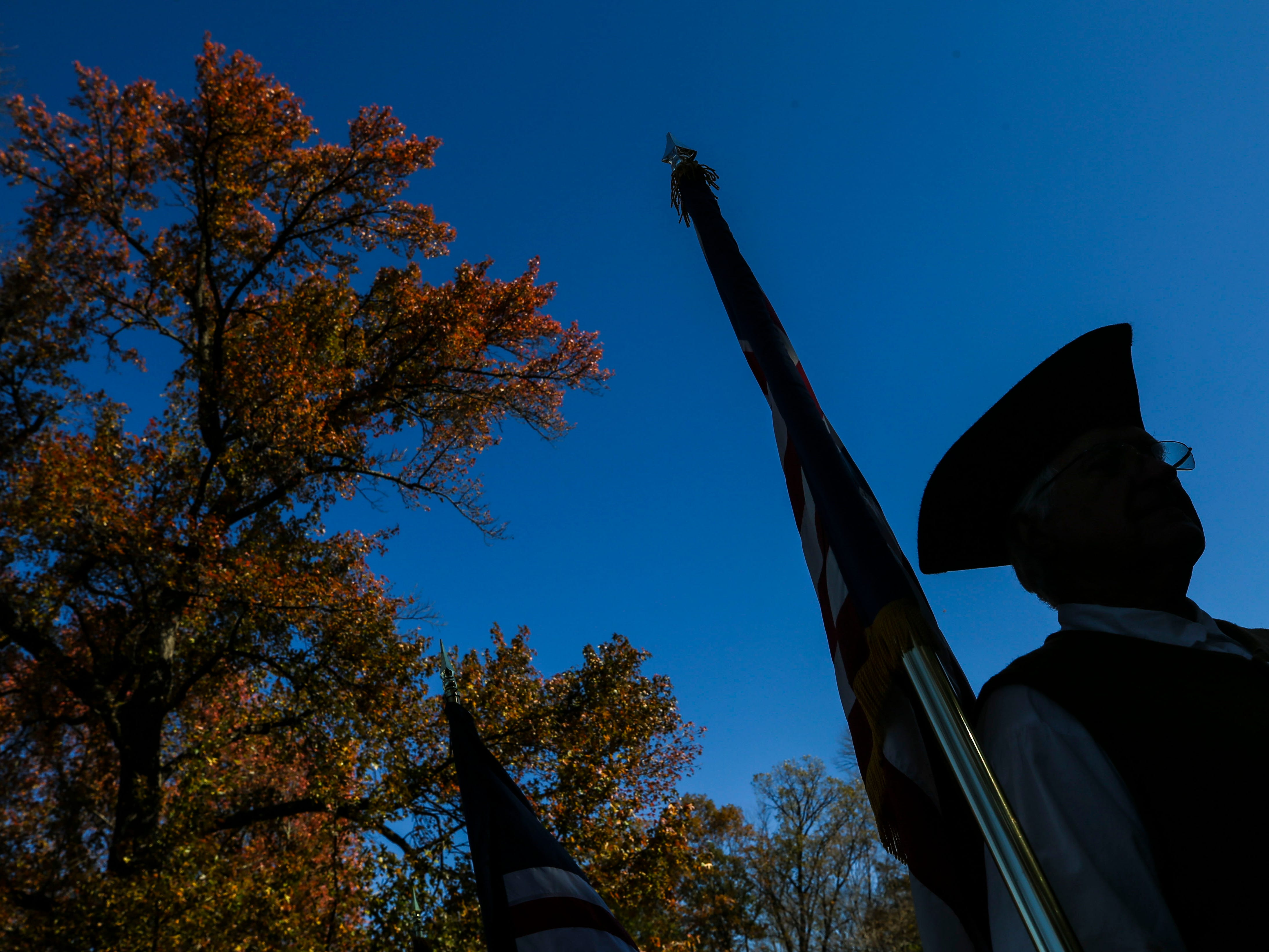 Larry Selpy stands at attention during the Flags 4 Vets ceremony at Cave Hill Cemetery Saturday morning.