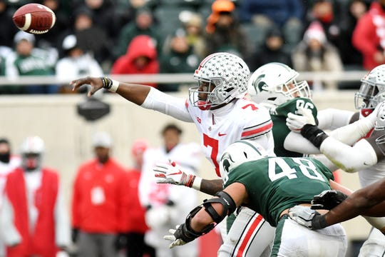 Michigan State's Kenny Willekes, right, closes in on Ohio State's Dwayne Haskins Jr. as he throws a pass during the fourth quarter on Saturday, Nov. 10, 2018, in East Lansing.