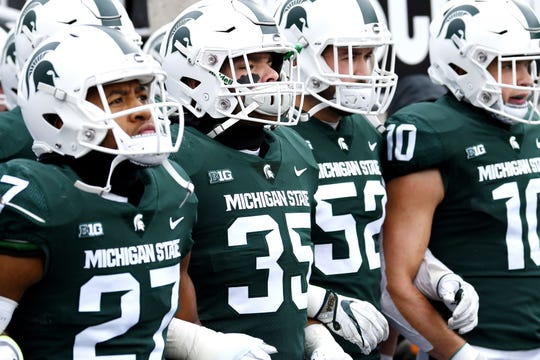 Members of the Michigan State defense, from left, Khari Willis, Joe Bachie, Dillon Alexander and Matt Morrissey take the field before the game against Ohio State on Saturday, Nov. 10, 2018, in East Lansing.