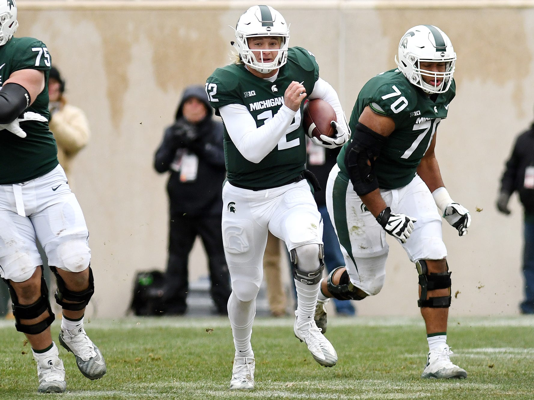 Michigan State's Rocky Lombardi runs for a first down during the third quarter on Saturday, Nov. 10, 2018, in East Lansing.