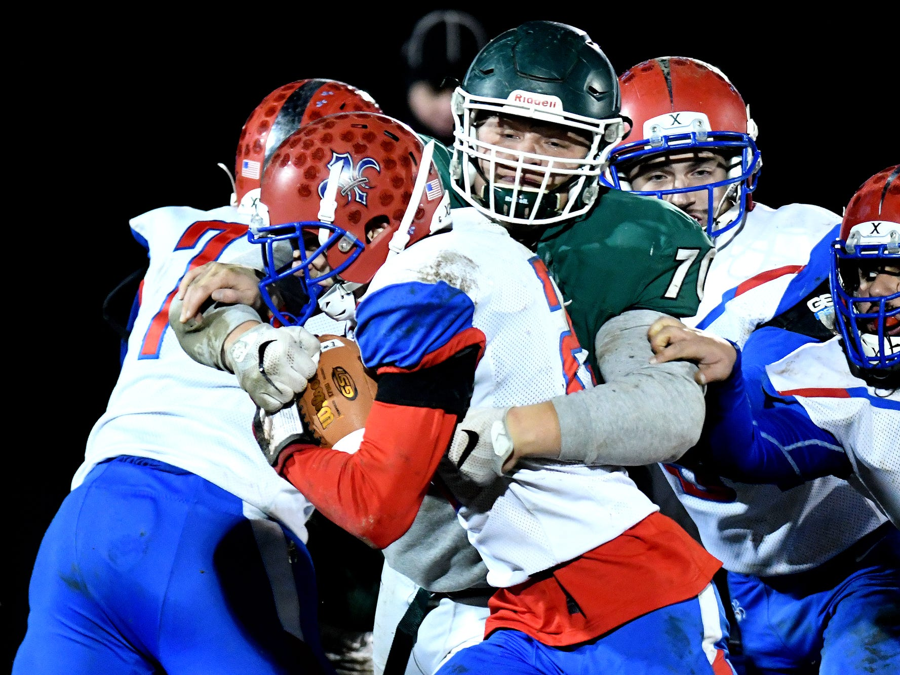 Williamston's Eston Miles, right, tackles St. Clair's Ethan Mahn during the second quarter on Friday, Nov. 9, 2018, in Williamston.