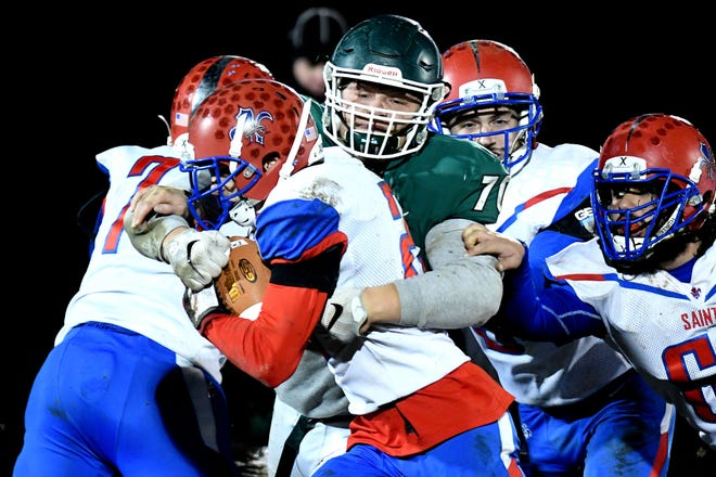 Williamston's Eston Miles, right, tackles St. Clair's Ethan Mahn during the second quarter of a playoff game in November. Miles has attracted plenty of offers and interest from Division I programs over the last few months.