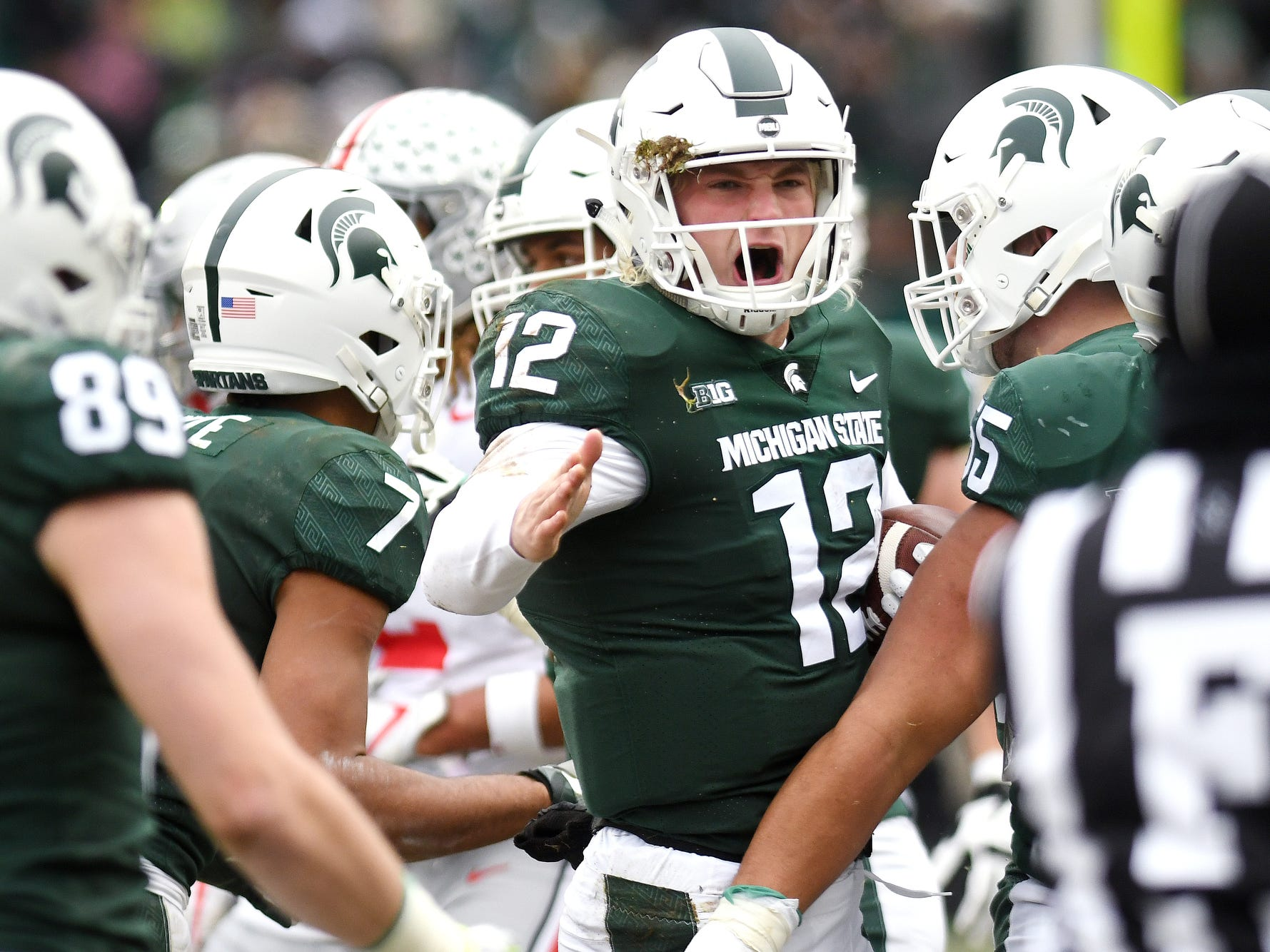 Michigan State's Rocky Lombardi celebrates after a long run for a first down during the third quarter on Saturday, Nov. 10, 2018, in East Lansing.