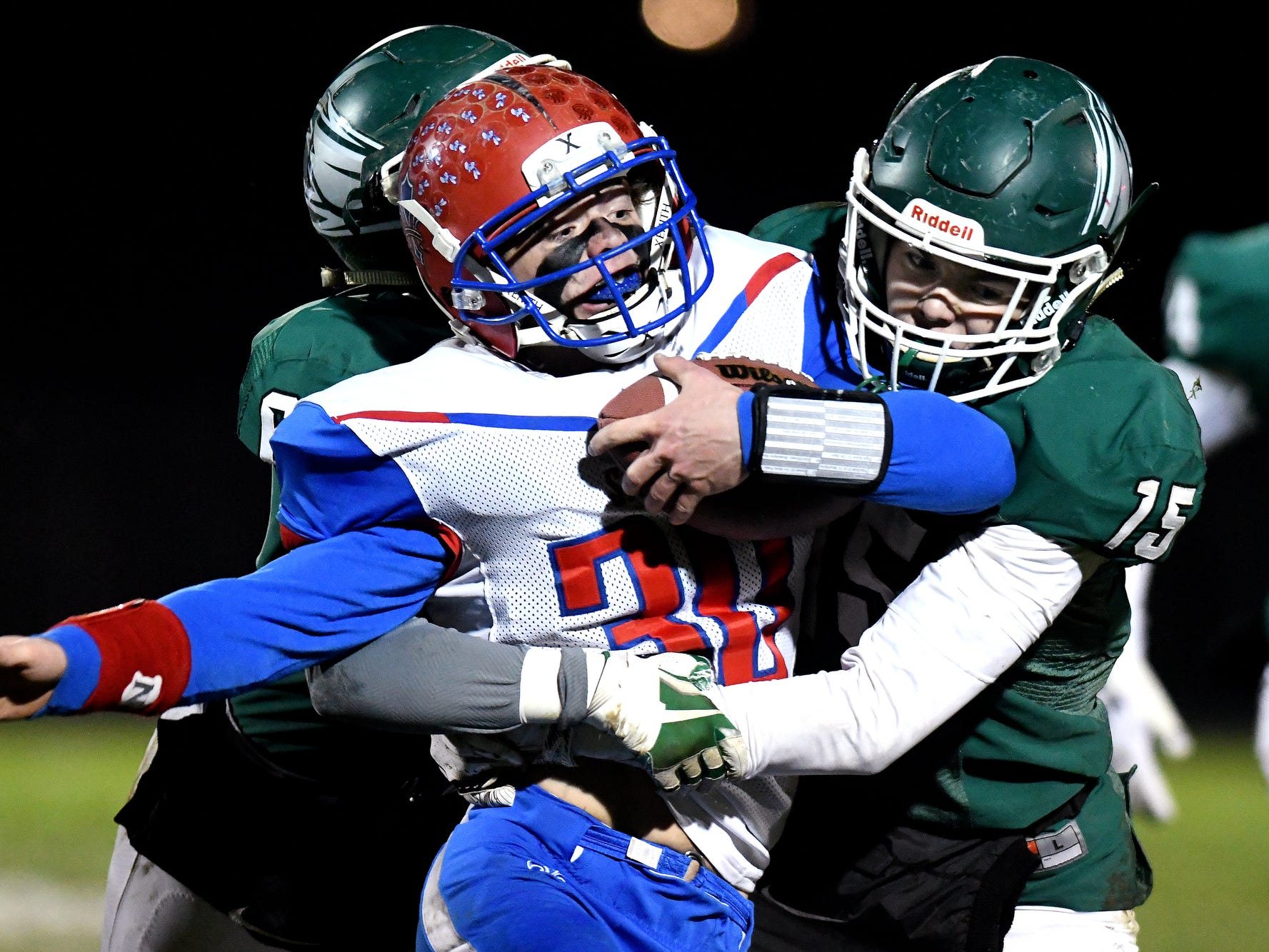 Williamston's Jackson Slocum, right, and Alvin Habba tackle St. Clair's Branden Reuba during the first quarter on Friday, Nov. 9, 2018, in Williamston.