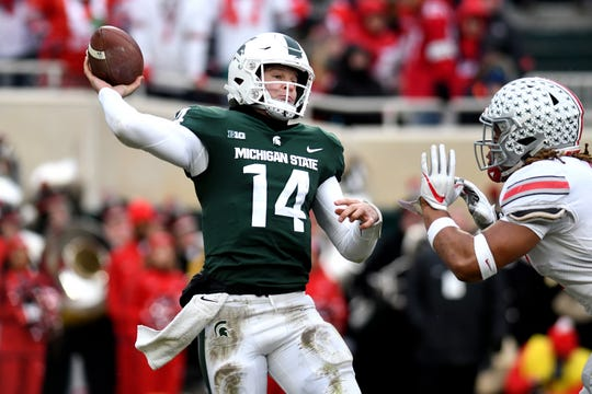 Michigan State's Brian Lewerke, left, throws the ball as Ohio State's Chase Young pressures during the fourth quarter on Saturday, Nov. 10, 2018, in East Lansing.