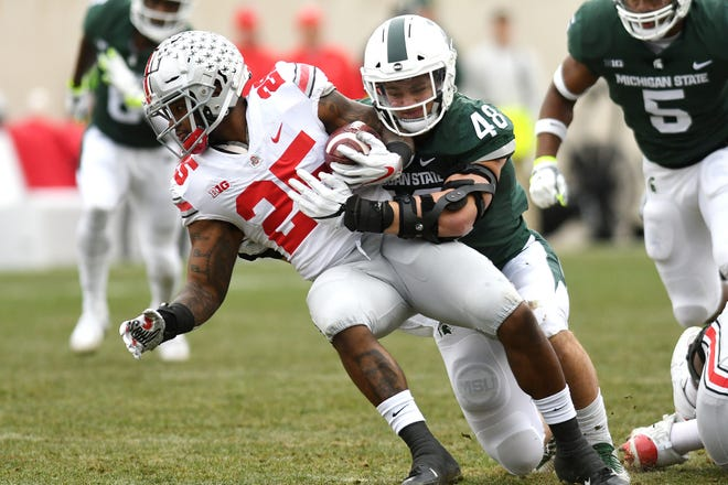 Michigan State's Kenny Willekes, right, tackles Ohio State's Mike Weber Jr. during the first quarter on Saturday, Nov. 10, 2018, in East Lansing.