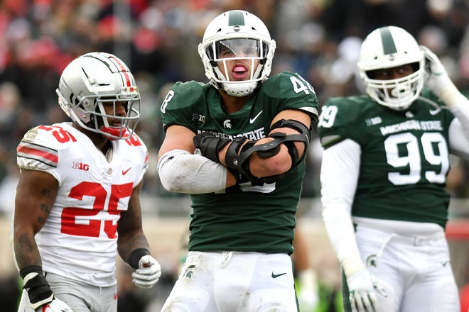 Michigan State's Kenny Willekes celebrates after a sack during the second quarter on Saturday, Nov. 10, 2018, in East Lansing.