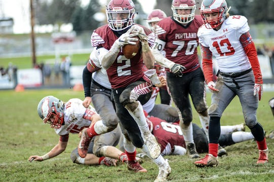 Portland's Jacob Veale (2) picks up yardage against Frankenmuth Saturday, Nov. 10, 2018. Portland won 40-6 to advance to the semi-finals.