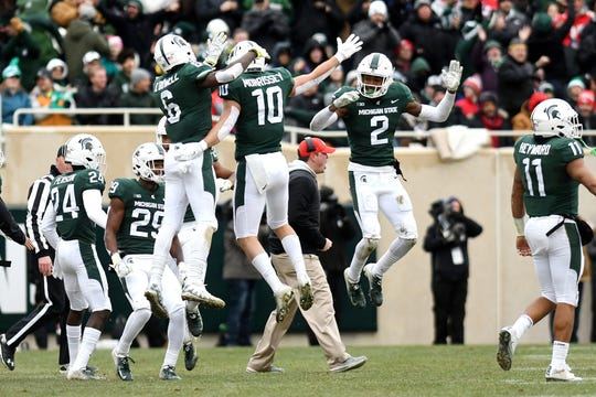 From left, Michigan State's David Dowell, Matt Morrissey and Justin Layne celebrate after Ohio State misses a field goal during the second quarter on Saturday, Nov. 10, 2018, in East Lansing.