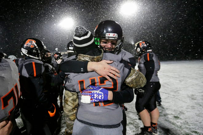 Reedsville's Carson Schanilec embraces teammate Cole Ebert after losing to Edgar in a WIAA Division 7 semifinal Friday at Waupaca High School.