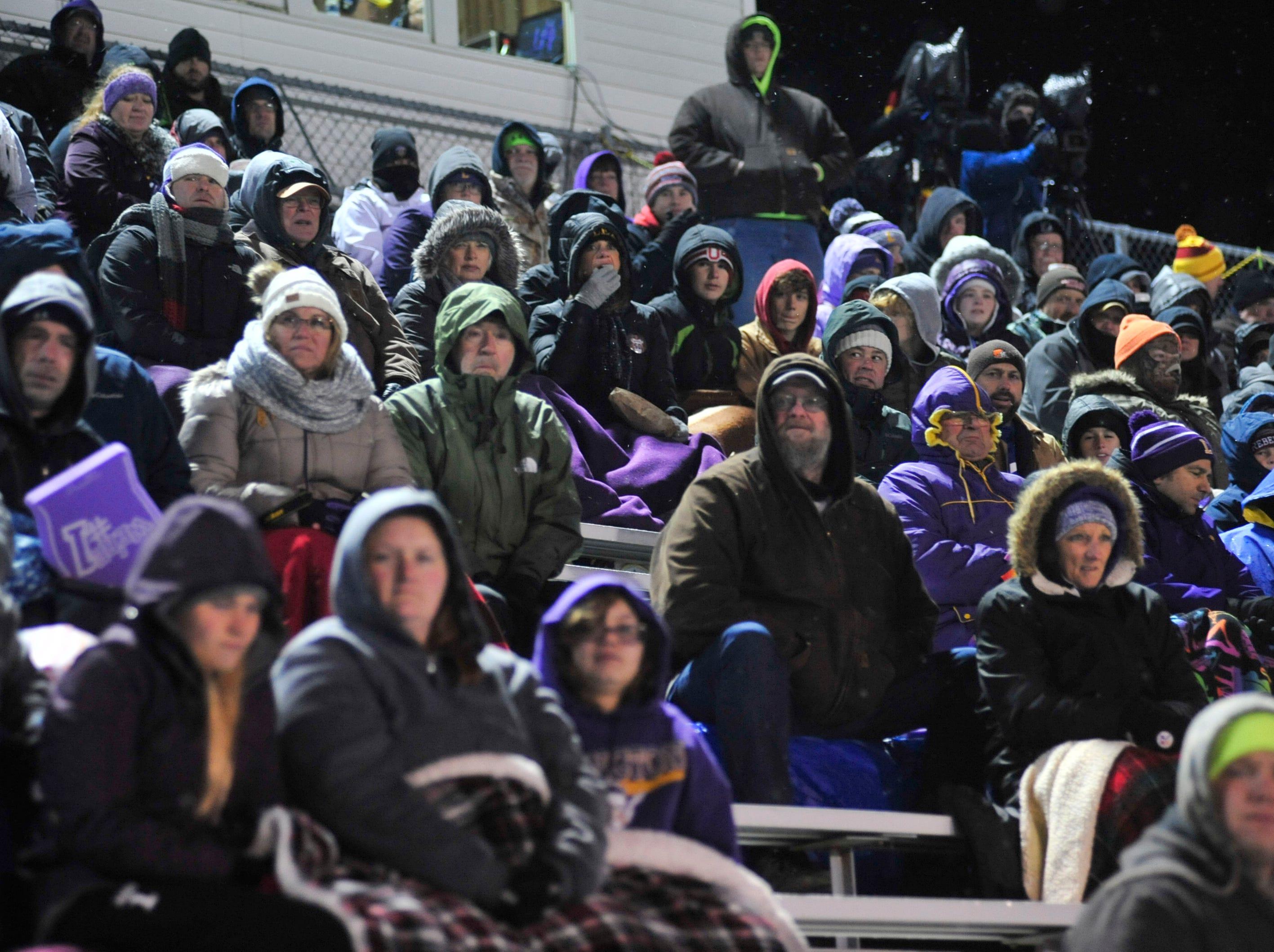 Lexington fans watch their football team play against Sandusky at Willard High School on Friday.