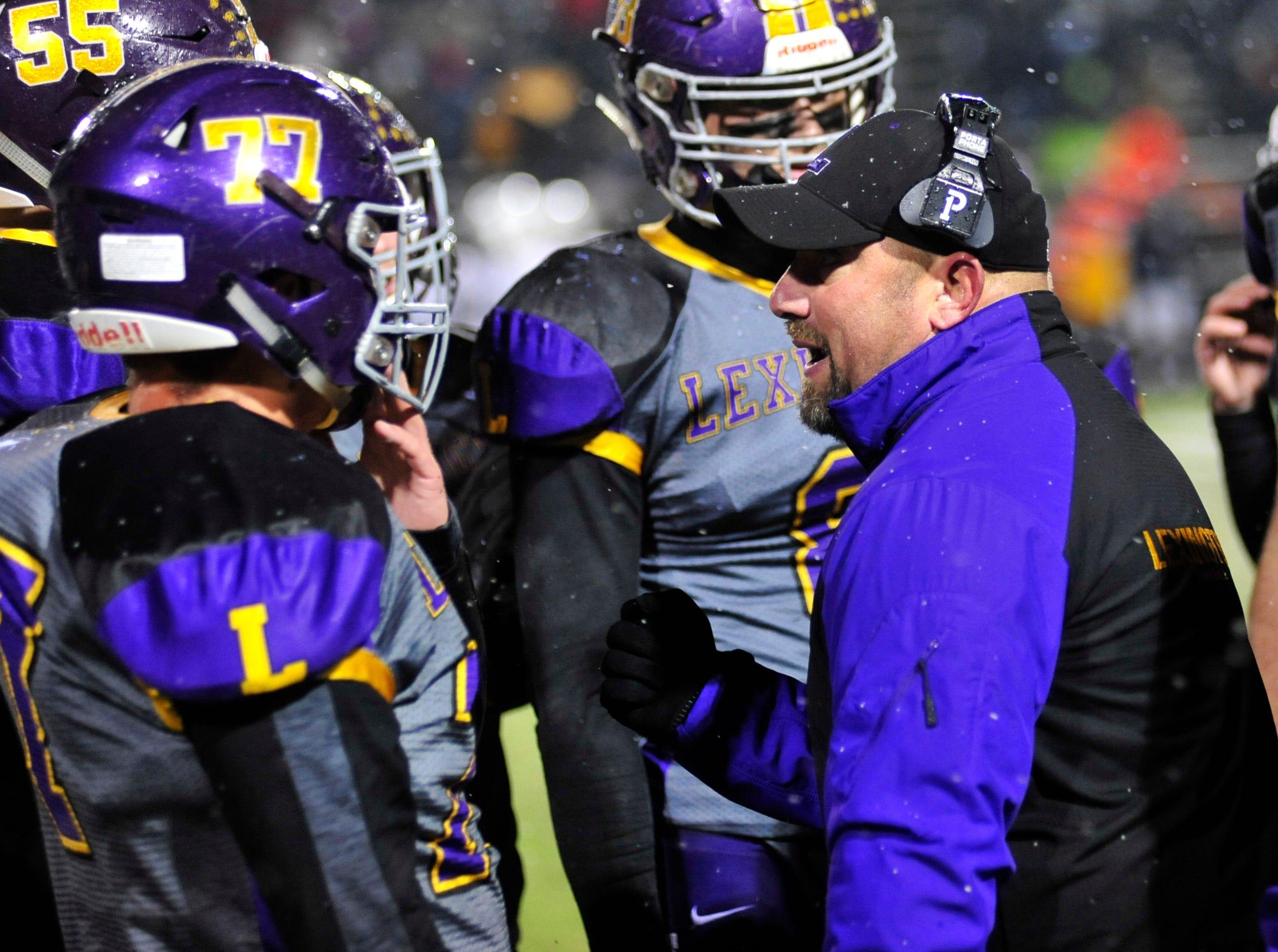 Lexington head coach Taylor Gerhardt talks to his players as they play against Sandusky while playing at Willard High School on Friday.