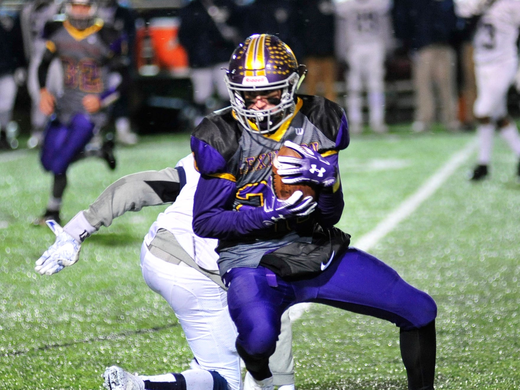 Lexington's Dylan Christman runs with the ball while playing at Willard High School on Friday.