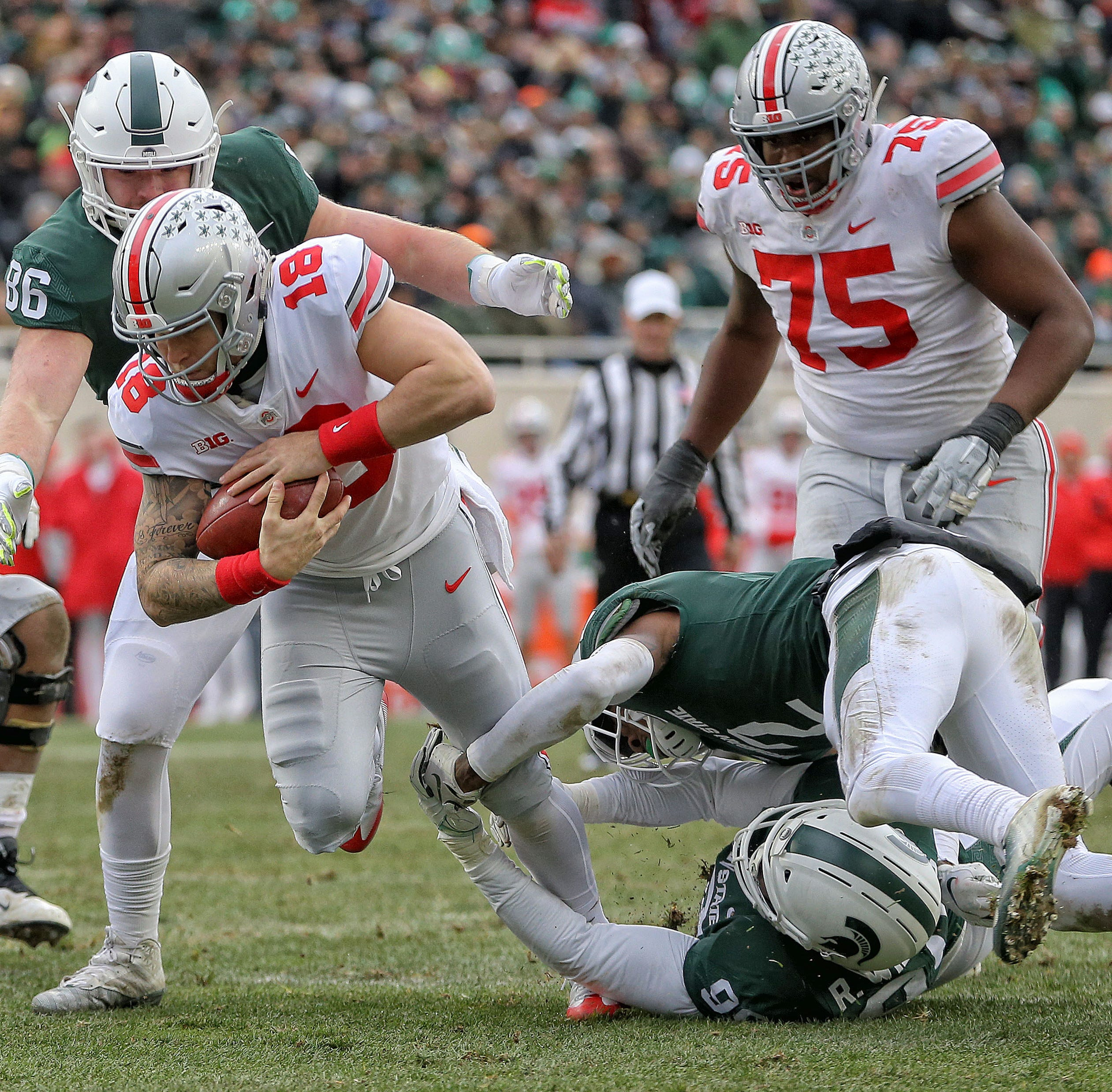 Ohio state quarterback Tate Martell, used in a goal-line package, picks up five yards from the 6 to set up a first half touchdown against Michigan State.