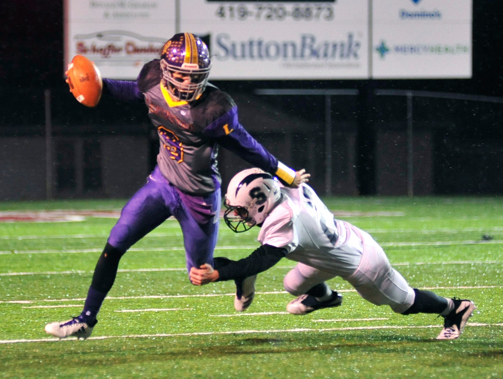 Lexington's Jake Depperschmidt out maneuvers a Sandusky player while playing at Willard High School on Friday.