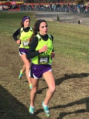 Allison Johnson, front, and Baylee Hack of Mount Gilead earned All-Ohio for the second straight year in Division III at the state cross country championships Saturday.