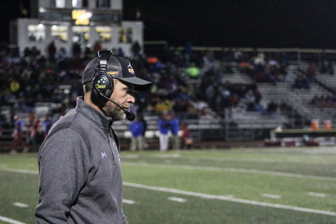 Northmor coach Scott Armrose walks the sidelines at Watkins Memorial during a Division VI, Region 23 semifinal with Beverly Fort Frye.