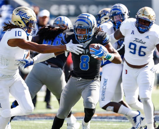 Memphis running back Darrell Henderson (middle) fights for positive yards against the Tulsa defense during action in Memphis, Tenn., Saturday, November 10, 2018.