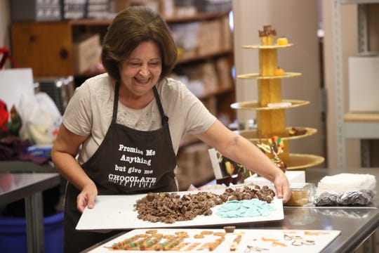 Kathy Faherty prepares a tray of assorted chocolates.
