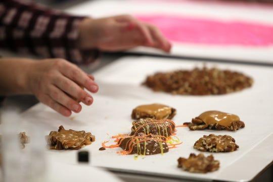 Toni Faherty prepares a tray of caramel turtles.