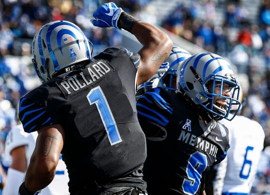 Memphis receiver Pop Williams (right) celebrates a touchdown with teammate Tony Pollard (left) during action Tulsa in Memphis, Tenn., Saturday, November 10, 2018.