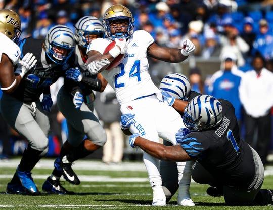 The Memphis defense brings down Tulsa running back during action in Memphis, Tenn., Saturday, November 10, 2018.