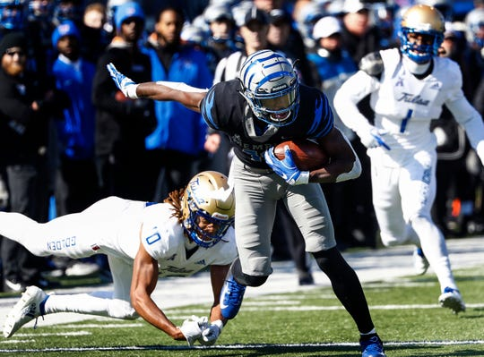 Memphis receiver Damonte Coxie (middle) makes a first down catch against the Tulsa defense during action in Memphis, Tenn., Saturday, November 10, 2018.