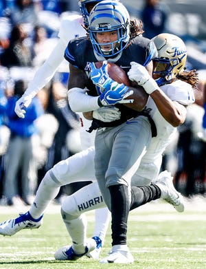 Memphis running back Darrell Henderson fights for positive yards against the Tulsa defense during action in Memphis, Tenn., Saturday, November 10, 2018.