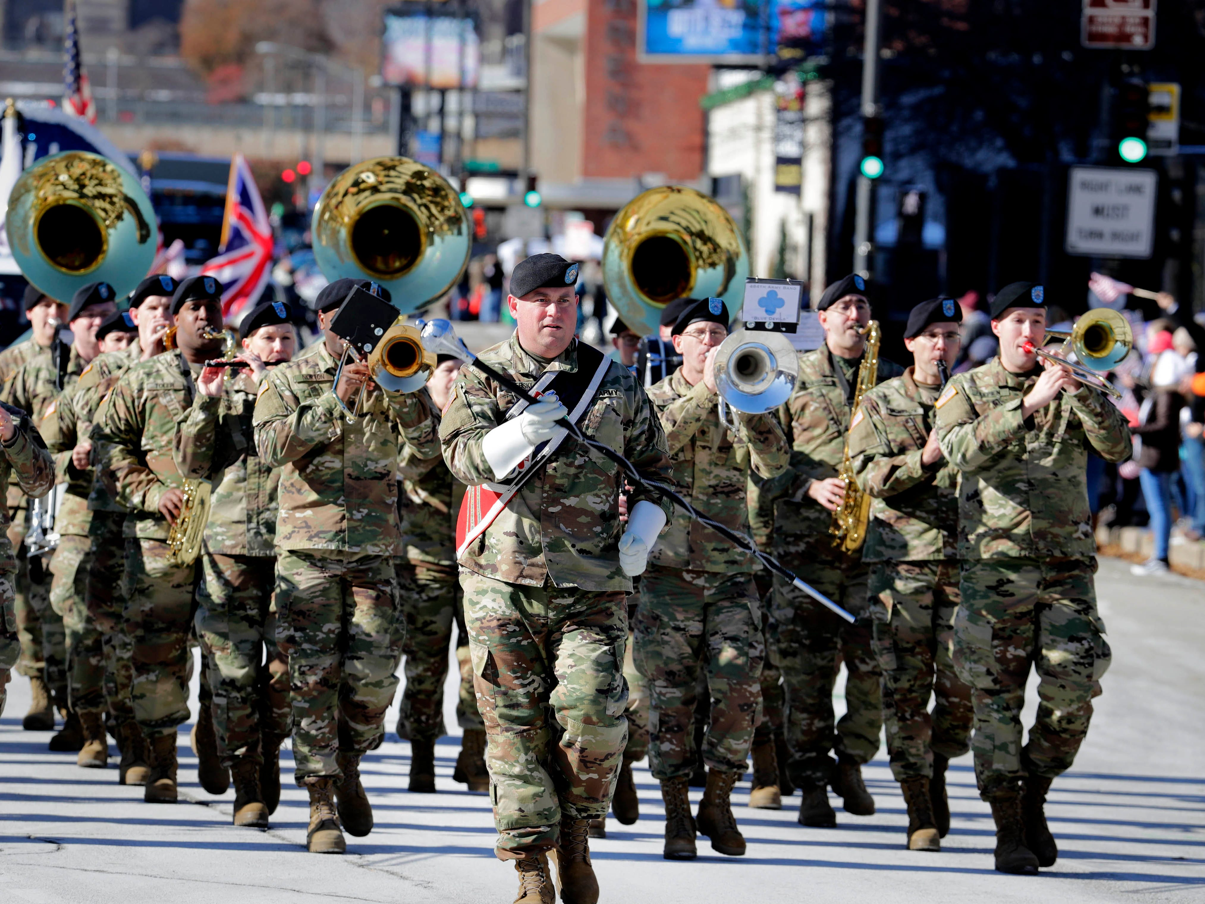 """Members of the 484th Army Band in Milwaukee  play """"As Those Caissons Go Rolling Along"""" during  Milwaukee's  Veterans Day parade on Saturday.  Ninety to 100 units participated in the parade, which commemorated  the centennial of the World War I armistice. A memorial service was also held at the Milwaukee County War Memorial."""