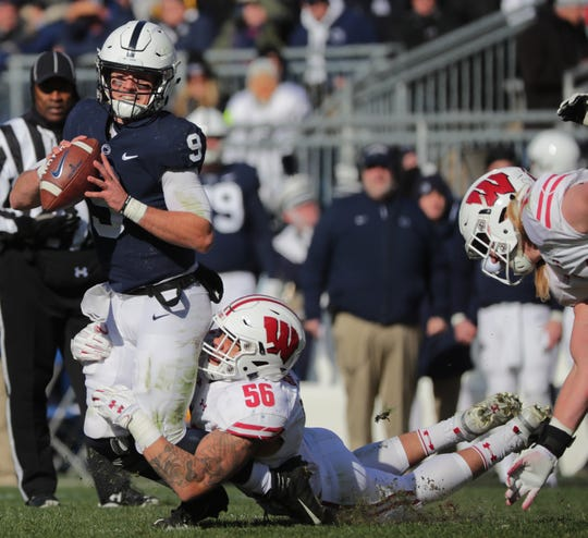 Penn State quarterback Trace McSorley is sacked by Wisconsin linebacker Zack Baun during a game last season. UW generated 19 sacks in 13 games in 2018, a drop from the previous season.