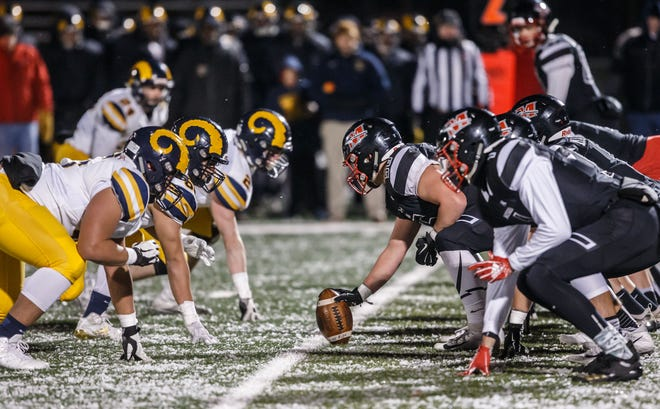 With its mitigation plan for the coronavirus was approved by the health department Monday, Marquette's football team (left) will be able to play this fall.