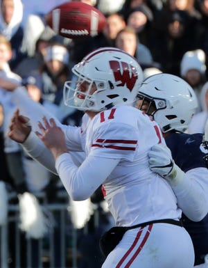 Wisconsin quarterback Jack Coan fumbles after being hit by Penn State defensive end Yetur Gross-Matos during the fourth quarter Saturday.