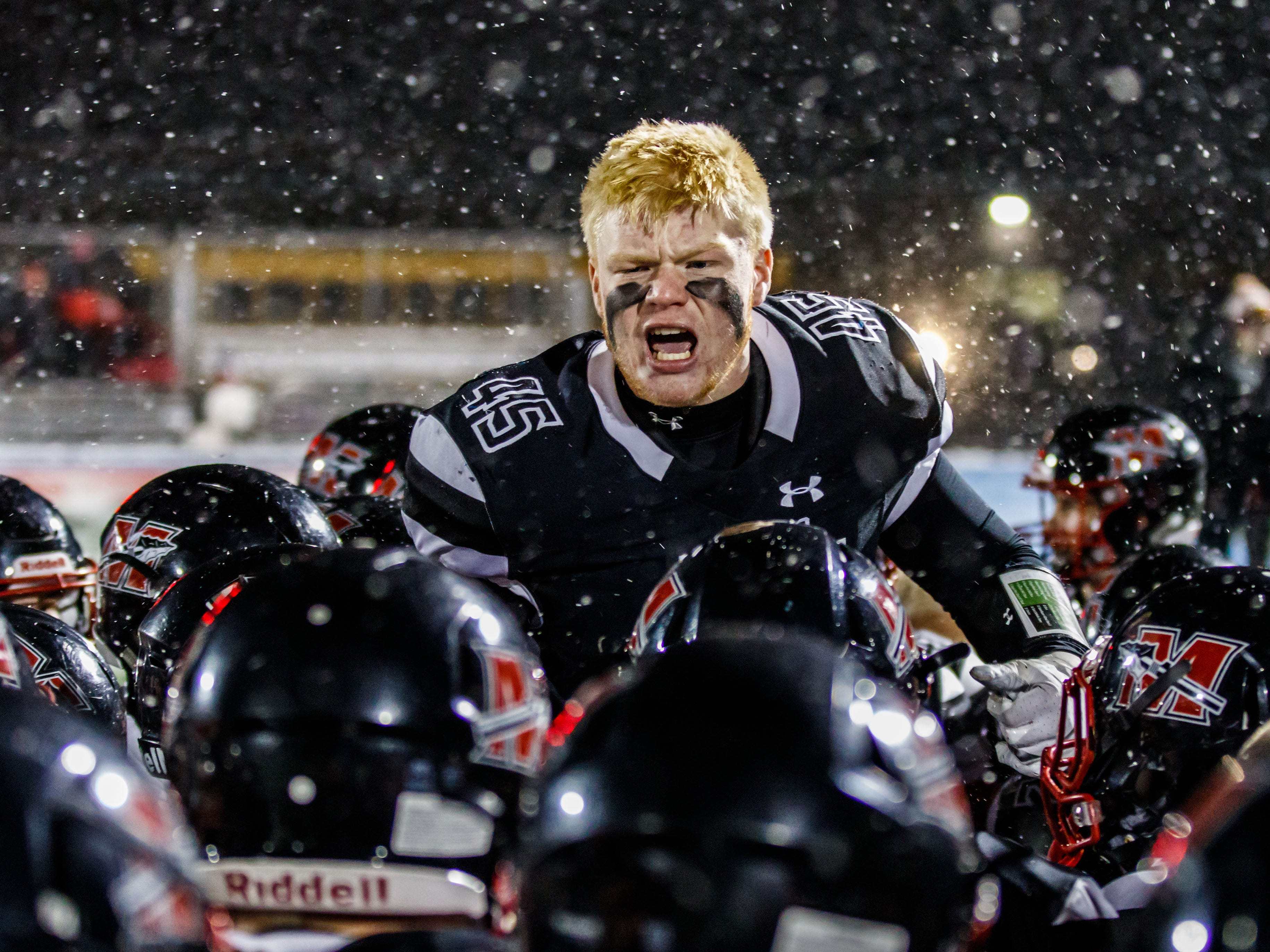 Muskego senior Mitch Borkovec (45) fires up his team prior to the WIAA Division 1 Level 4 playoff game against Marquette in Hartland on Friday, Nov. 9, 2018.