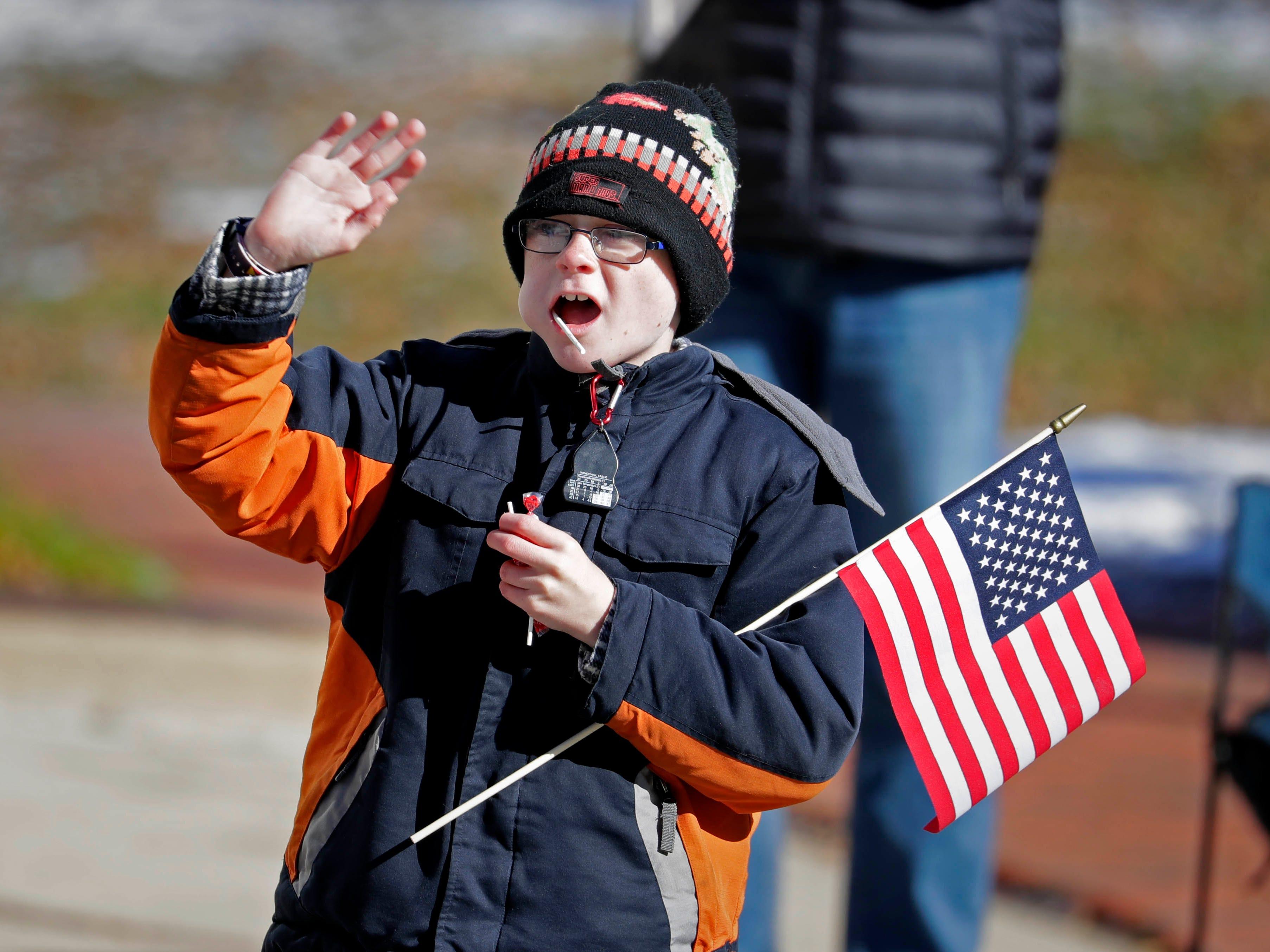 Wyatt Tietjen, 10, of Milwaukee waves to parade participants.