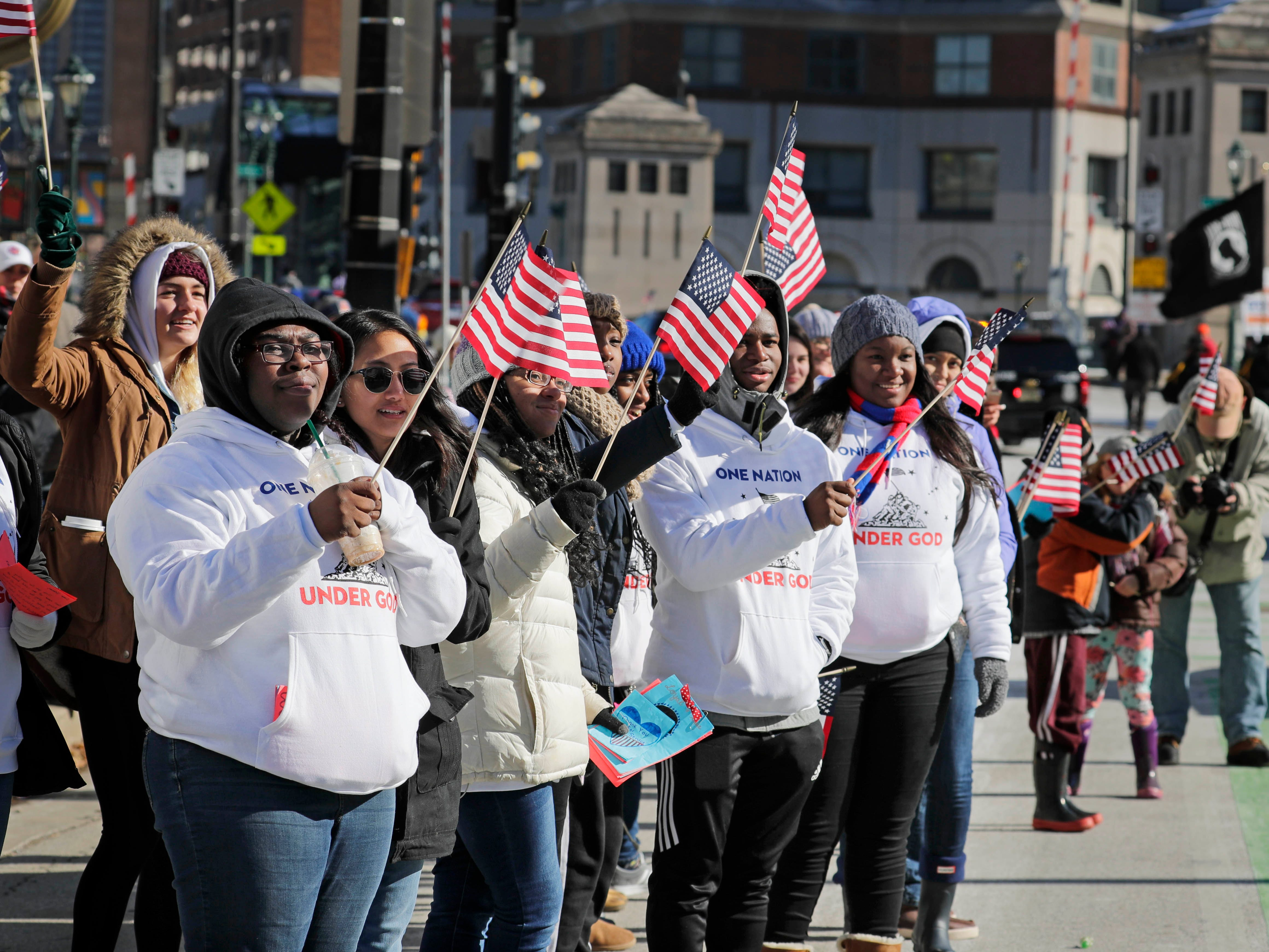 Students from the 2018-'19 class at Wisconsin Lutheran High School cheer the veterans and displays passing along the parade route.