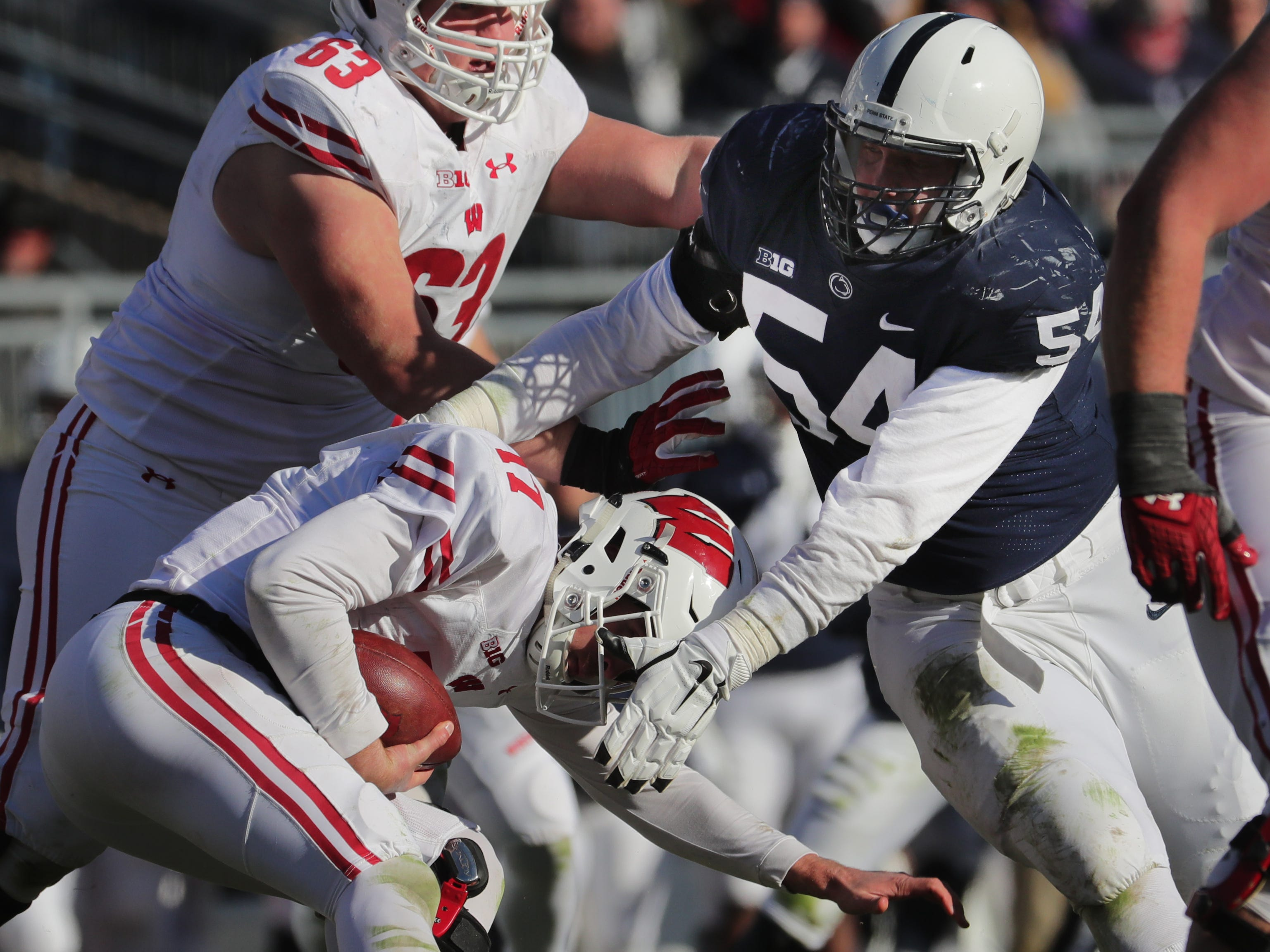 Penn State defensive tackle Robert Windsor sacks Wisconsin quarterback Jack Coan during the third quarter Saturday,