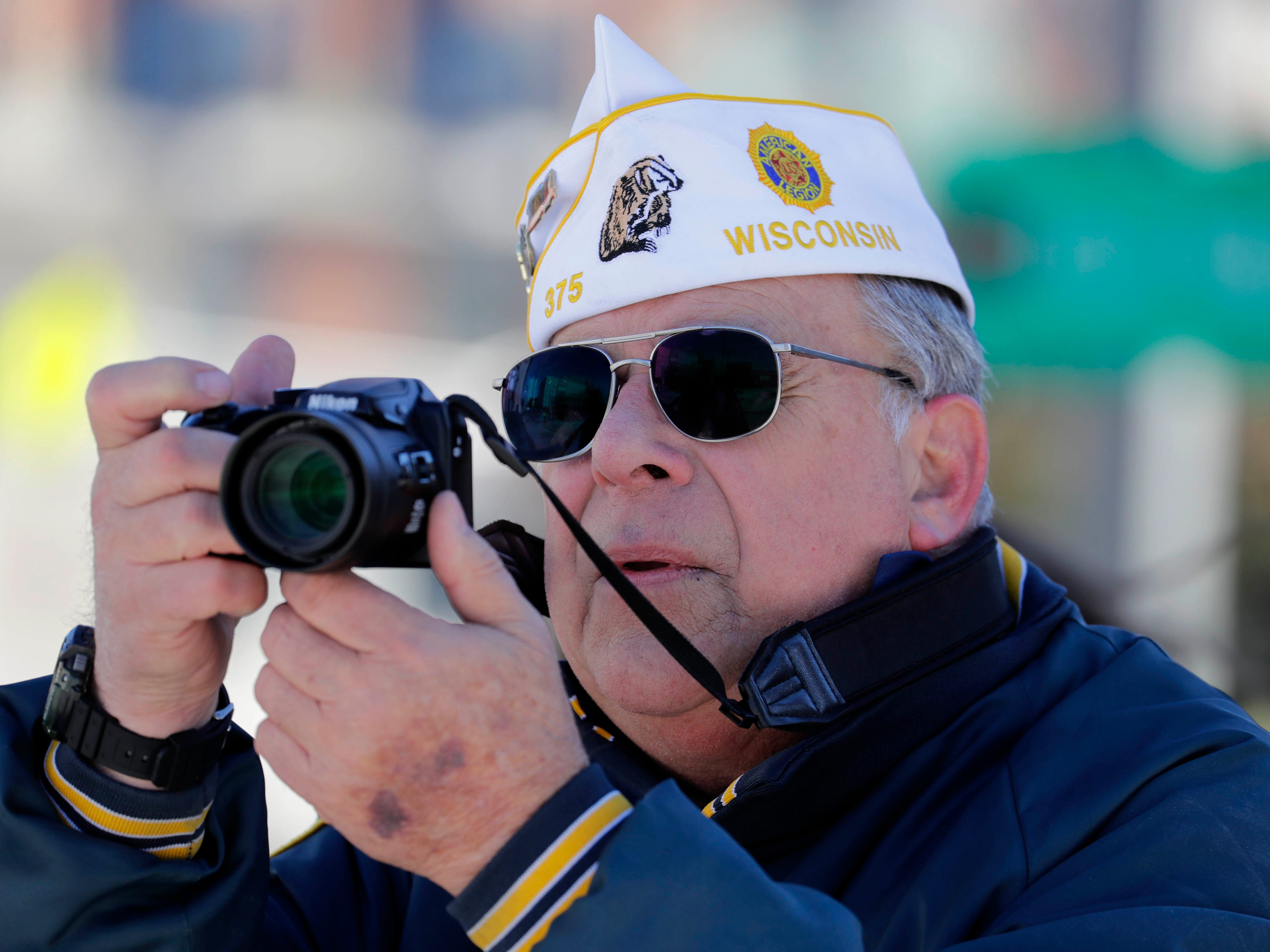 Jeff Antczak, Department of American Legion historian, captures video and still images of the veterans parade.
