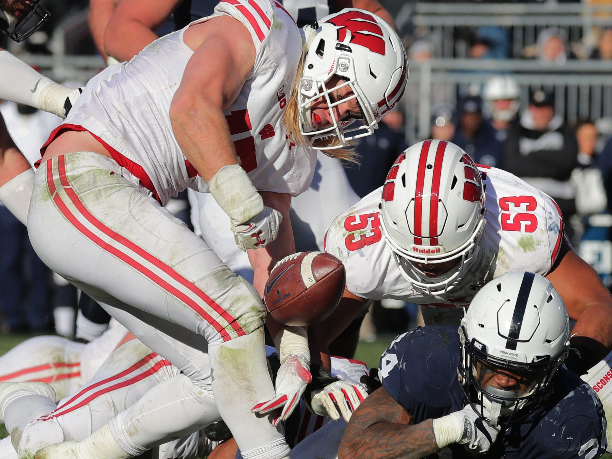 Wisconsin linebacker Andrew Van Ginkel (left) strips the ball from Penn State running back Miles Sanders during the fourth quarter Saturday.