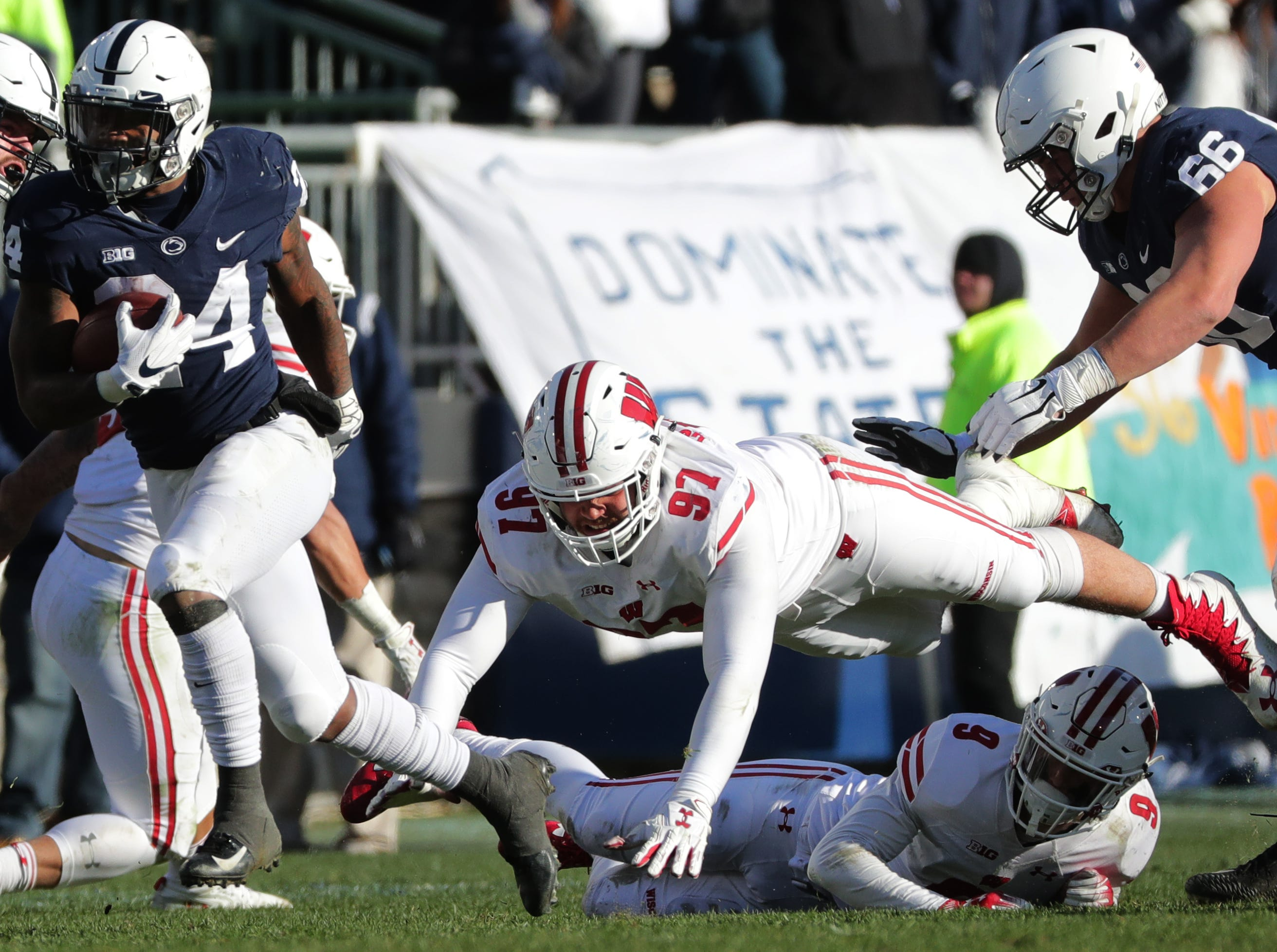 Penn State running back Miles Sanders eludes the grasp of Wisconsin defensive end Isaiahh Loudermilk during the third quarter Saturday.