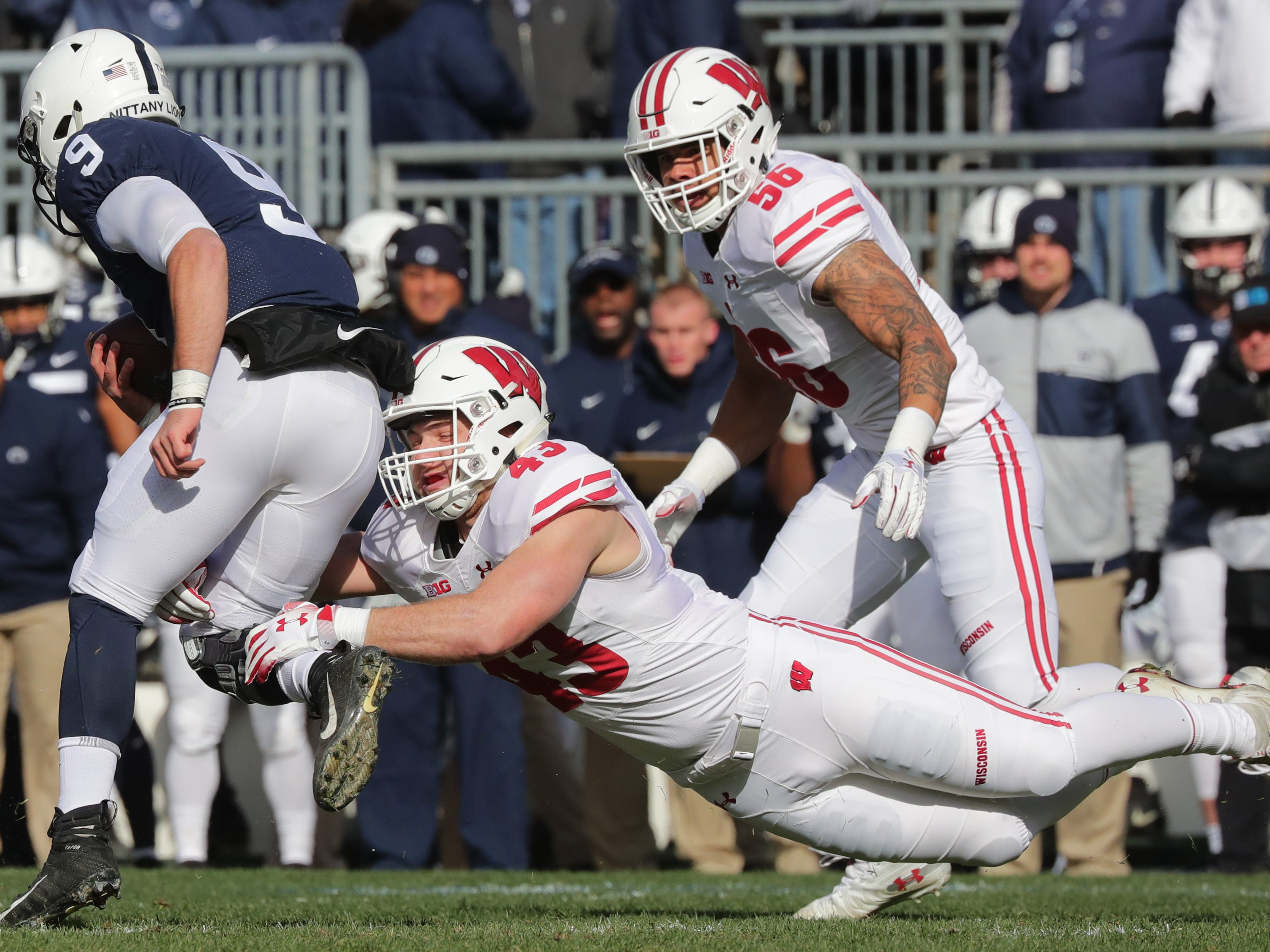 Wisconsin linebacker Ryan Connelly stops Penn State quarterback Trace McSorley after a short gains during the first quarter Saturday.