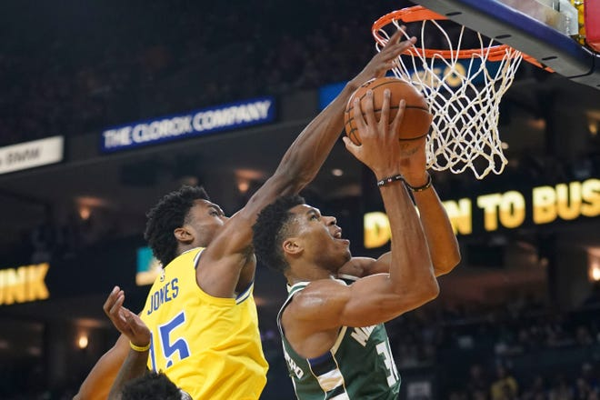 November 8, 2018; Oakland, CA, USA; Milwaukee Bucks forward Giannis Antetokounmpo (34) shoots the basketball against Golden State Warriors center Damian Jones (15) during the third quarter at Oracle Arena. Mandatory Credit: Kyle Terada-USA TODAY Sports