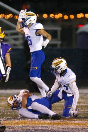 Catholic Memorial's Cole Dakovich recovers a New Berlin Eisenhower fumble during WIAA Division 3 Level 4 play Nov. 9 at Kettle Moraine. Dakovich committed to Wisconsin on Friday.