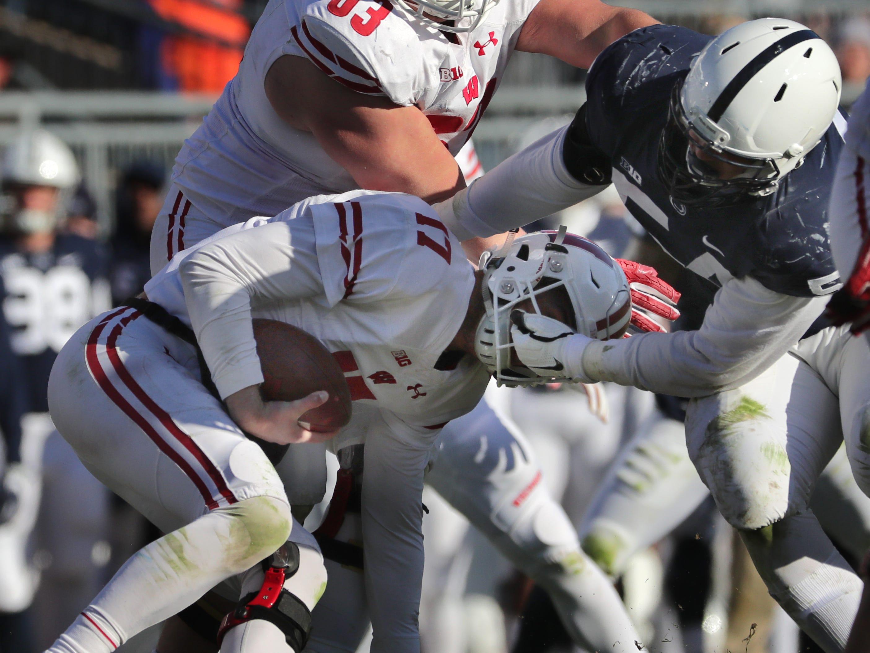 Penn State defensive tackle Robert Windsor grabs some face mask as he sacks Wisconsin quarterback Jack Coan during the third quarter Saturday.