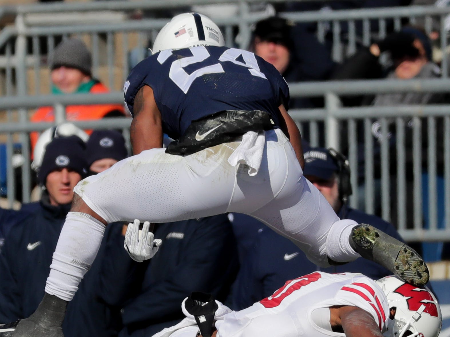 Penn State running back Miles Sanders hurdles Wisconsin cornerback Faion Hicks picking up a first down during the second quarter Saturday.