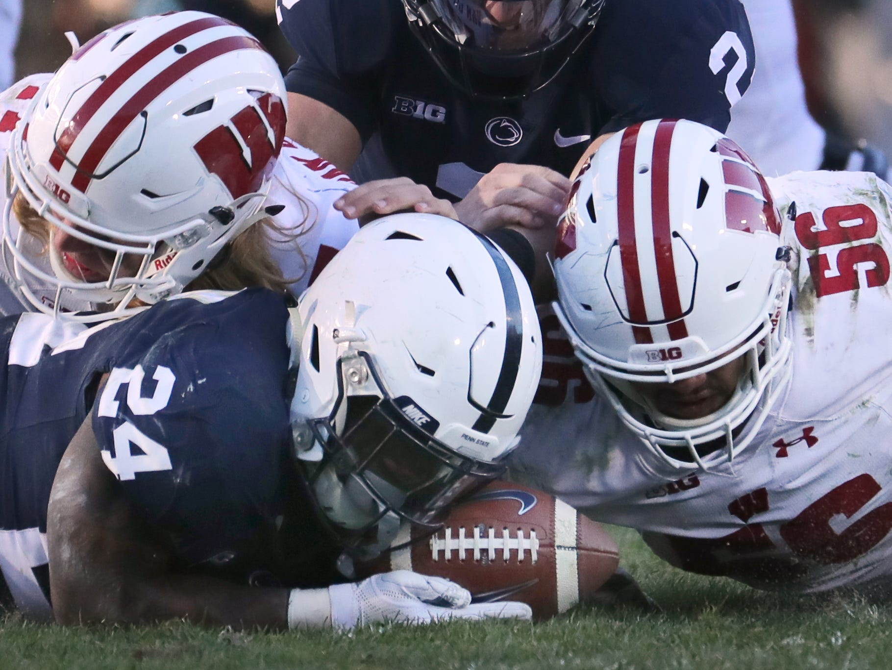 Wisconsin linebacker Zack Baun (56) recovers a fumble against  Penn State late in the fourth  quarter Saturday.