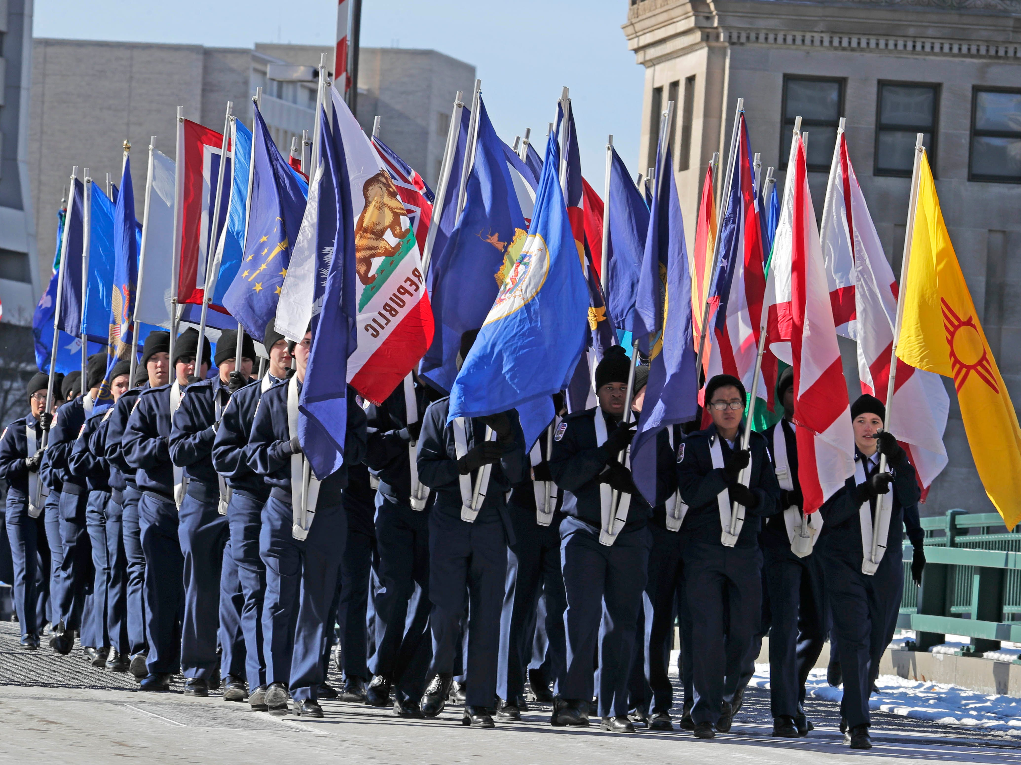 Students from the Greenfield High School JROTC program march along the parade route.