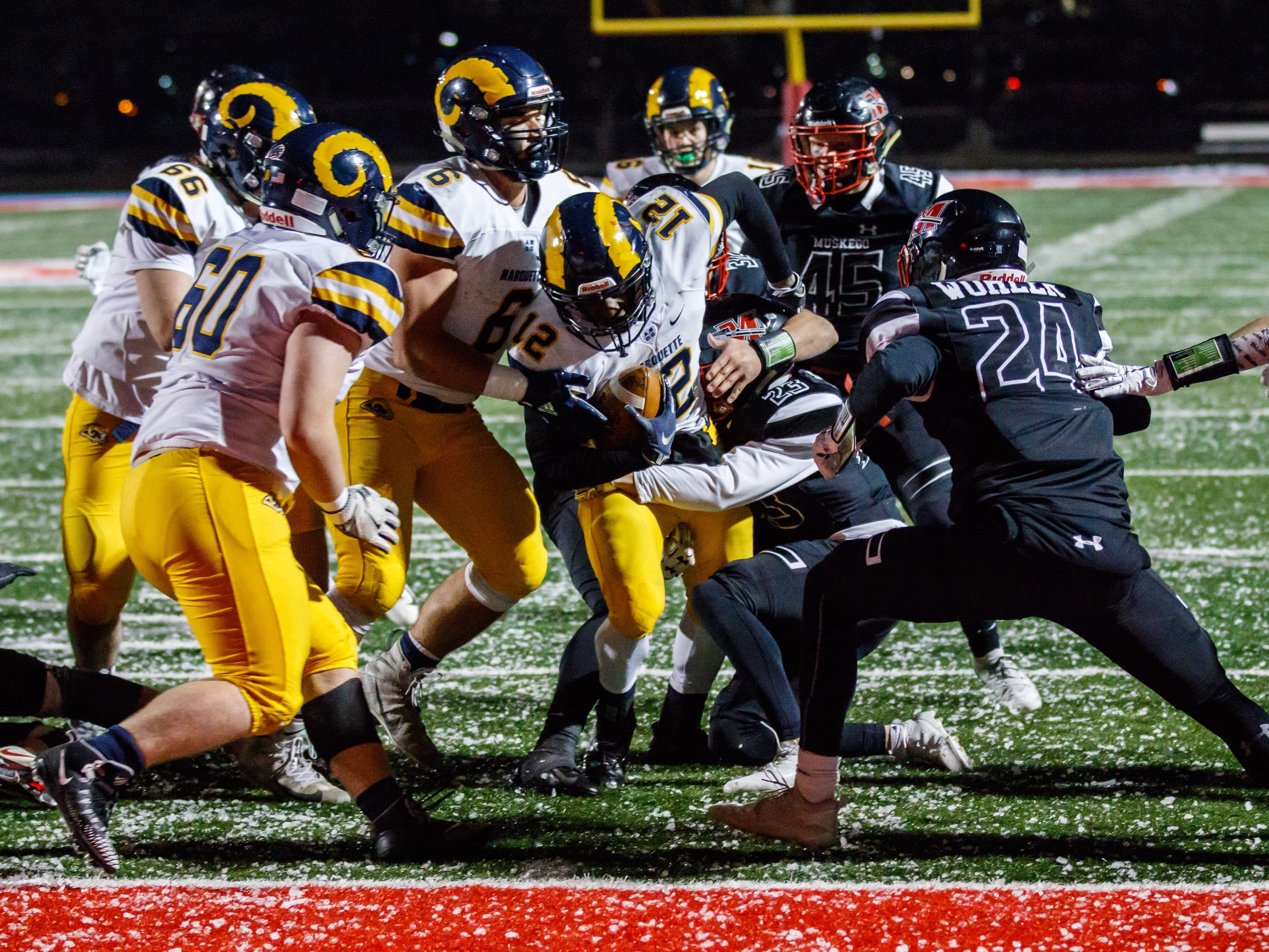 Marquette running back Daeleon Brown-Williams (12) is stopped by Muskego defenders at the goal line on forth down in the third quarter during the WIAA Division 1 Level 4 playoff game on Friday, Nov. 9, 2018.