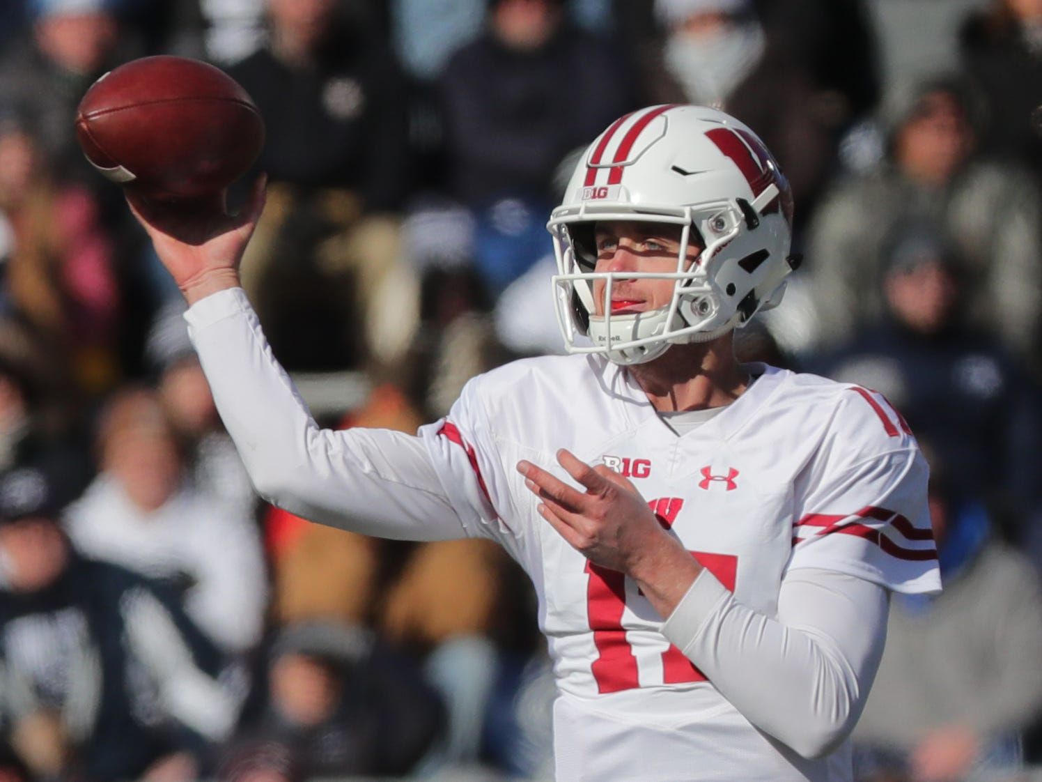 Wisconsin quarterback Jack Coan dumps off a pass against Penn State during the first quarter Saturday.